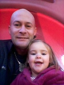 Tyler Ward Enix with his daughter, Brooklynne. Credit Knoxville Police Department