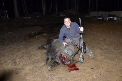 Thomas Blair with the wild boar he shot on his property in Moose Creek, Ont. on Monday, Nov. 16, 2015. Blair says the feral hog weighed in at 460 lbs. Reports of wild boars around Ottawa have been around since 2013. SUBMITTED IMAGE