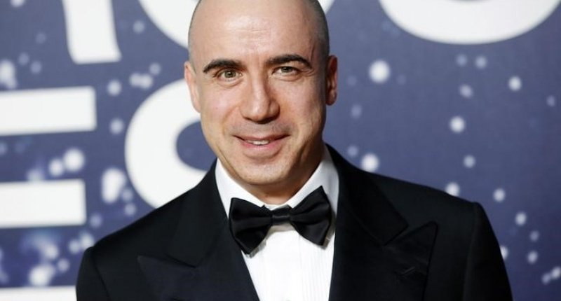 Russian entrepreneur and venture capitalist Yuri Milner arrives on the red carpet during the second annual Breakthrough Prize Awards at the NASA Ames Research Center in Mountain View, California November 9, 2014. REUTERS/Stephen Lam