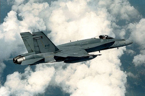 Royal Canadian Air Force CF-18 Hornets depart after refueling with a KC-135 Stratotanker assigned to the 340th Expeditionary Air Refueling Squadron, October 30, 2014, over Iraq. THE CANADIAN PRESS/HO-U.S. Air Force, Staff Sgt. Perry Aston