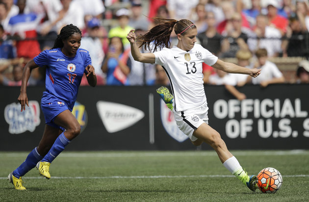 United States' Alex Morgan (13) dribbles the ball against Haiti Yvrose Gervil in the first half of a soccer game during the U.S. Women's World Cup victory tour, Sunday, Sept. 20, 2015, in Birmingham, Ala. The United States won 8-0. (AP Photo/Brynn Anderson)