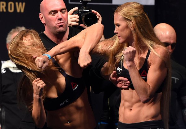 Rousey gets physical at UFC 193 weigh-ins