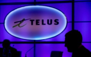 Telus Corp. announced it would boost its dividend to 44 cents per share next quarter. (Darryl Dyck/Canadian Press)