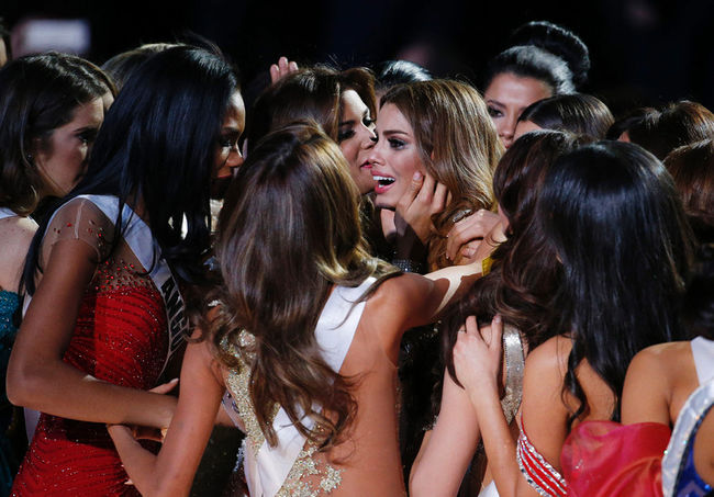 Other contestants comfort Miss Colombia Ariadna Gutierrez, centre, after she was incorrectly crowned Miss Universe at the Miss Universe pageant on Sunday, Dec. 20, 2015, in Las Vegas. (AP Photo/John Locher) AP
