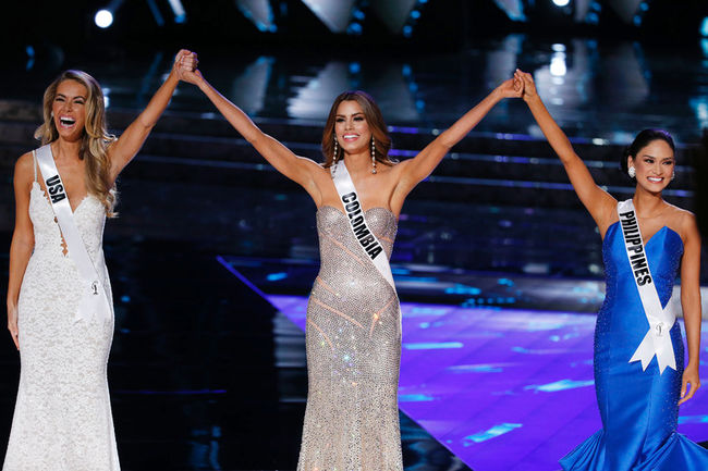 From left, Miss USA Olivia Jordan, Miss Colombia Ariadna Gutierrez and Miss Philippines Pia Alonzo Wurtzbach react as they make the final three at the Miss Universe pageant Sunday, Dec. 20, 2015, in Las Vegas. (AP Photo/John Locher) AP