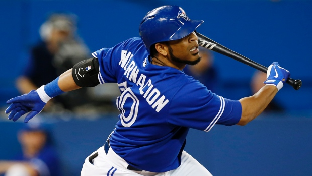 Toronto Blue Jays Edwin Encarnacion lets go of the bat after a swing during a game against the Baltimore Orioles on Sunday. With a nagging wrist injury causing him to lose grip of the bat, Encarnacion has been shut down for the season and will have wrist surgery. (Mark Blinch/Reuters)