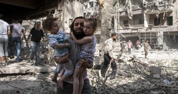 Russia bombs crowded market near Damascus, killing and wounding dozens