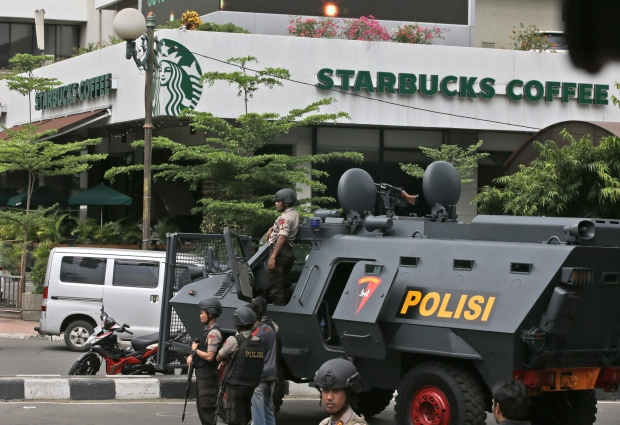 A police armoured vehicle is parked outside the Starbucks restaurant where a series of explosions went off. The attacks took place on a major downtown street in Jakarta, not far from the presidential palace and the U.S. Embassy. (Achmad Ibrahim/The Associated Press)