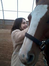 Terris with friend, Houston, a rescued slaughter horse from the U.S. through Stuck in the Mud Animal Rescue.