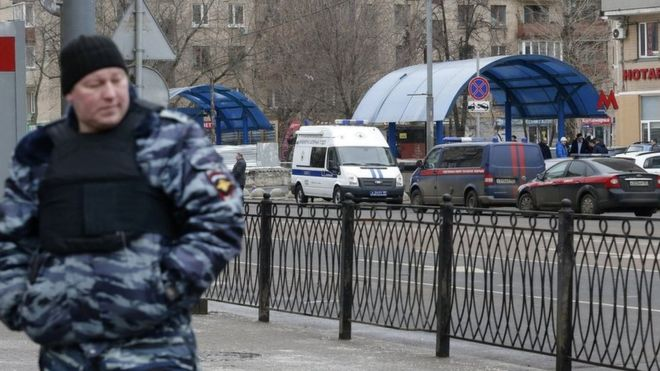 A policeman stands guards near the Moscow metro station where the beheading suspect was arrested - Reuters