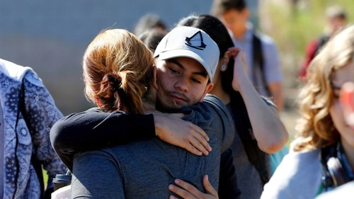 Parents and students reunite Friday after two teens were shot at Independence High School in the Phoenix suburb of Glendale. (Matt York/Associated Press)