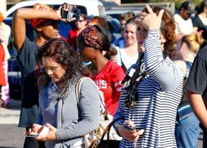 Anxious parents wait to see their children on Friday after receiving word two students had been shot to death at Independence High School in Glendale, Ariz. (Matt York/Associated Press)