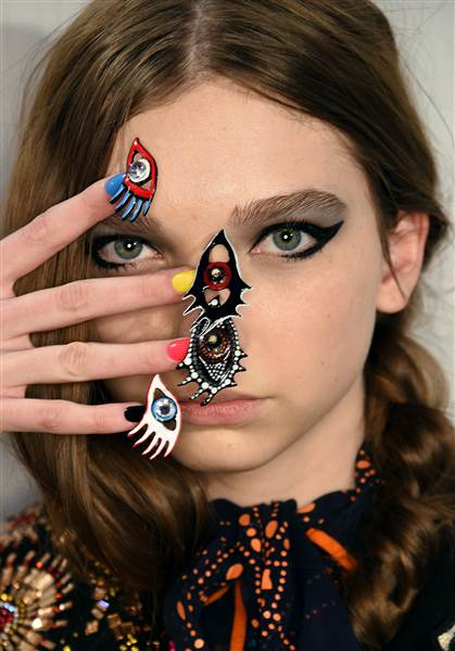 ennifer Graylock / Getty Images Other nail designs at the show included 3-D eyes with lashes to match