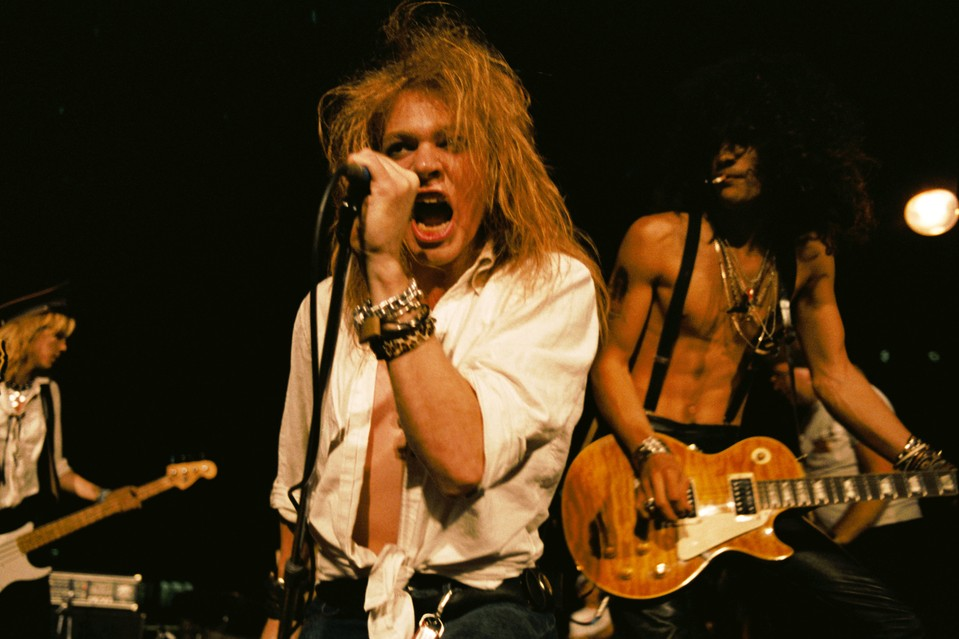 (L-R) Duff McKagan, Axl Rose and Slash of the rock group 'Guns n' Roses' perform at the LA Street Scene on September 28, 1985 in Los Angeles, California. Slash uses a Gibson Les Paul electric guitar for the first time onstage with the band. PHOTO: MARC S CANTER/MICHAEL OCHS ARCH