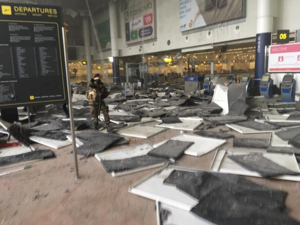 Screams and debris in Brussels airport after blast