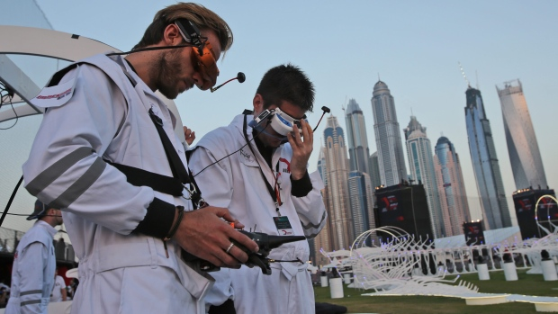 A pilot controls their team drone during the final day of the first World Drone Prix in Dubai, United Arab Emirates. (Kamran Jebreili/The Associated Press)