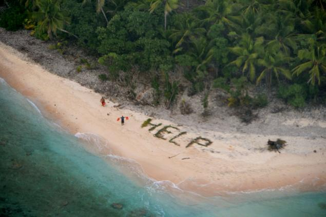 Three sailors rescued off desert Pacific island after spelling 'help' with palm