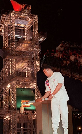 ATLANTA, GA - JULY 20: Former heavyweight boxing champion and 1960 OlympIc gold medallist Muhammad Ali lights the flame 19 July at the Olympic Stadium in Atlanta during the opening ceremoy for the 1996 Olympics. The flame will stay lit until the end of the Games 04 August. (FOR EDITORIAL USE ONLY) AFP-IOPP/Omar TORRES (Photo credit should read AF/AFP/Getty Images)