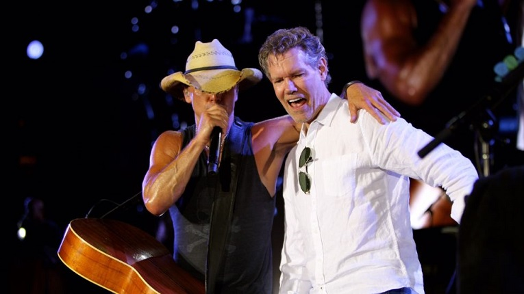 Kenny Chesney shares the spotlight With Randy Travis in Dallas