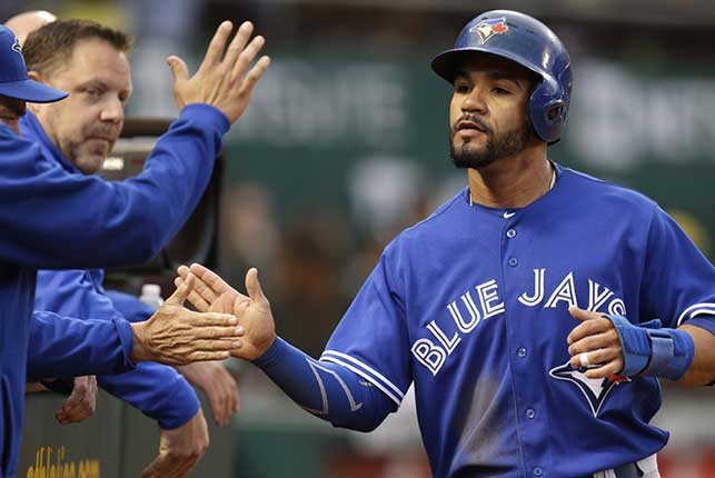 Travis homers twice to lift Blue Jays past Royals