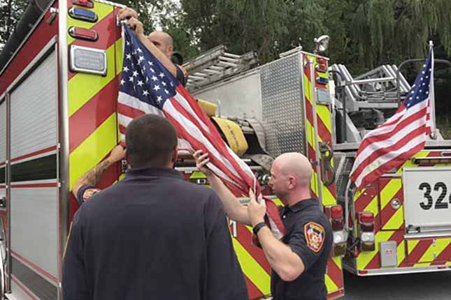 US flags called 'liability,' ordered removed from New York fire trucks
