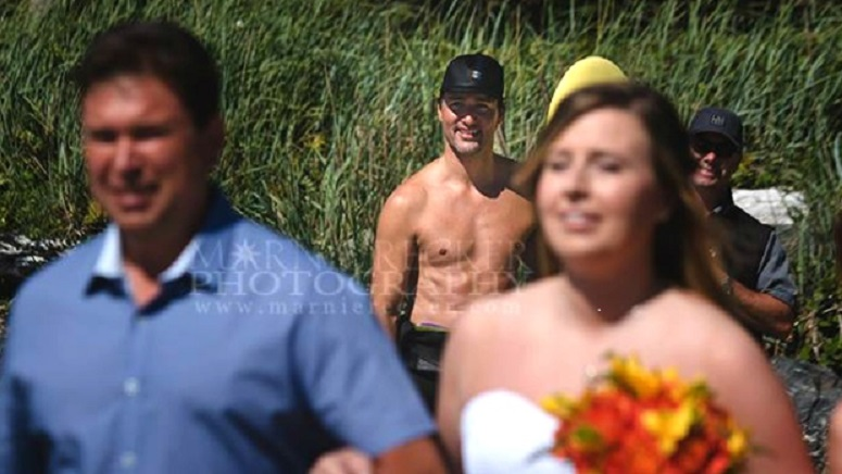 Shirtless Justin Trudeau accidentally photo bombs B.C. beach wedding