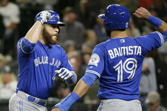 Blue Jays offence awakens to help Happ reach milestone