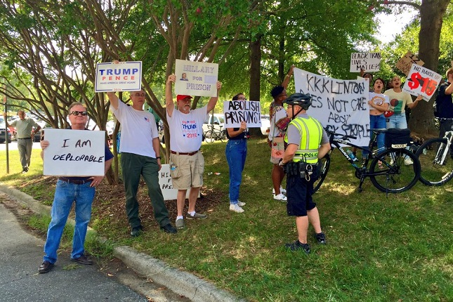 "A handful of protesters outside Hillary Clinton's event in Greensboro. One man's sign: ""I AM DEPLORABLE"""