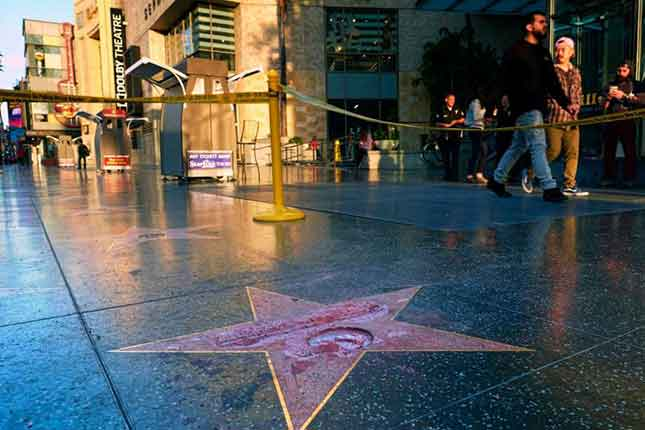 Video of the man posing as a construction worker destroying Trump star on Hollywood walk of fame