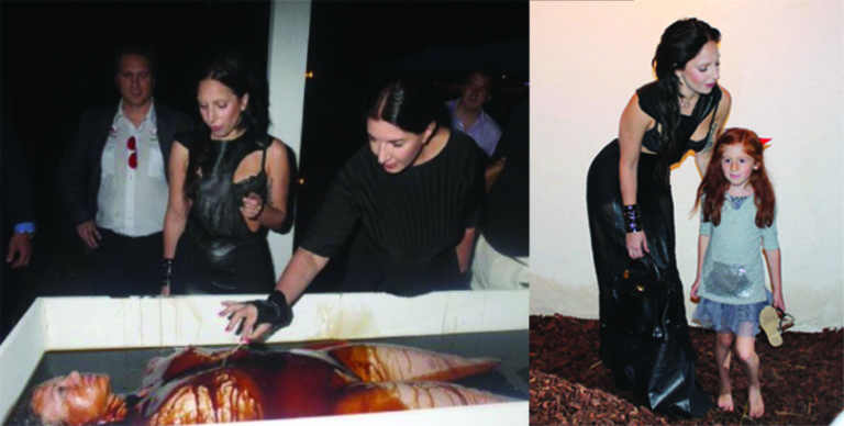 "Lady Gaga and Marina Abramovic (of 'Spirit Cooking' fame) attend a benefit at ""Devil's Heaven"" where guests partook in pretend cannibalism (R) Lady Gaga poses with a ""friend"" at the same event. Why was an unsupervised young child attending this gruesome event? Credit – Vigilant Citizen"