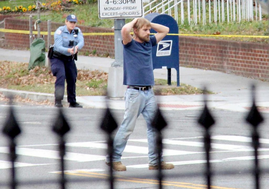 Edgar Maddison Welch, 28 of Salisbury, N.C., surrenders to police outside the Comet Ping Pong pizzeria. (AP)