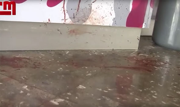 Footage from the scene shows vast amounts of blood splattered on the floor